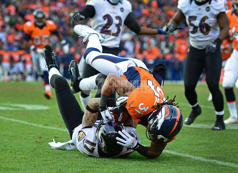 Jan 12, 2013; Denver, CO, USA; Baltimore Ravens wide receiver Tandon Doss (17) is tackled by Denver Broncos cornerback Omar Bolden (31) during the AFC divisional round playoff game at Sports Authority Field.  Mandatory Credit: Mark J. Rebilas-