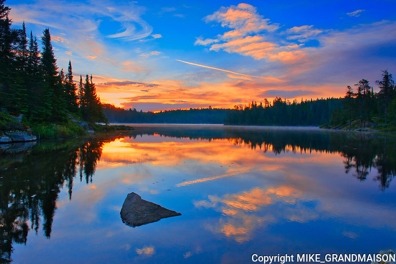 Sunrise reflection on Caribou Lake<br />