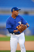 Dunedin Blue Jays outfielder Derrick Loveless (14) warms up before the second game of a doubleheader against the Palm Beach Cardinals on July 31, 2015 at Florida Auto Exchange Stadium in Dunedin, Florida.  Dunedin defeated Palm Beach 4-0.  (Mike Janes/Four Seam Images)