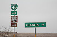 Road signs still show the way to the Ghost Town of Glenrio Texas on Route 66.