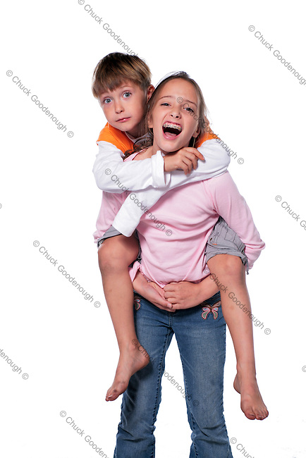 Photo of a Sister giving her Brother a Piggy Back Ride