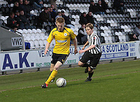 Liam Dick being closed down by Barry Cuddihy in the St Mirren v Falkirk Clydesdale Bank Scottish Premier League Under 20 match played at St Mirren Park, Paisley on 30.4.13. .
