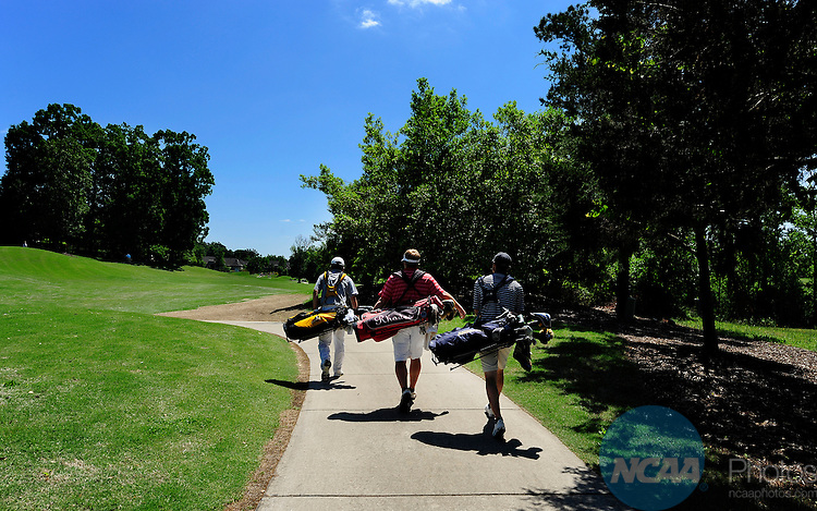 16 MAY 2014:  A group of golfers walk down a cart path during the Division III Men's Golf Championship held at the Grandover Resort in Greensboro, NC.  Jeffrey Camarati/NCAA Photos
