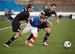 Marc McKenzie tries to squeeze past Partick duo Stuart Brannigan and Sean Welsh