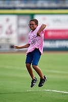 A young fan dances during the first game of a doubleheader between the Clearwater Threshers and the Lakeland Flying Tigers on June 14, 2017 at Spectrum Field in Clearwater, Florida.  Lakeland defeated Clearwater 5-1.  (Mike Janes/Four Seam Images)