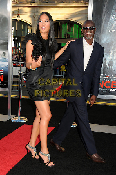 "KIMORA LEE SIMMONS & DJIMON HOUNSOU .""Inception"" Los Angeles Film Premiere held at Grauman's Chinese Theatre, Hollywood, California, USA, .13th July 2010..full length dress black ruffles ruffle  clutch bag navy blue suit white shirt jacket sunglasses goatee beard facial hair married couple husband wife sandals .CAP/ADM/BP.©Byron Purvis/AdMedia/Capital Pictures."