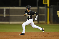 UCF Knights infielder Kam Gellinger (3) running the bases on a double during the opening game of the season against the Siena Saints on February 13, 2015 at Jay Bergman Field in Orlando, Florida.  UCF defeated Siena 4-1.  (Mike Janes/Four Seam Images)