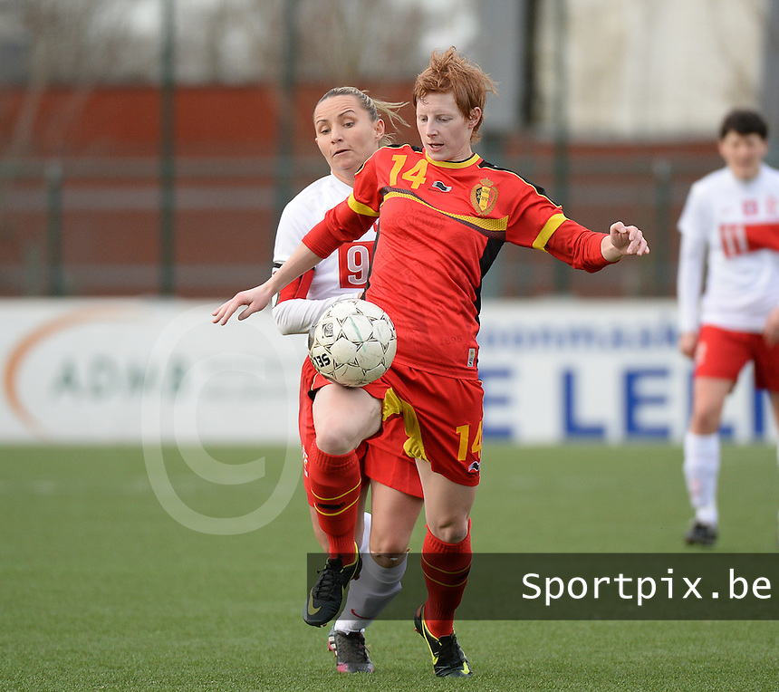 20140208 - OOSTAKKER , BELGIUM : Belgian Lien Mermans (r) pictured with Polish Patrycja Pozerska during a friendly soccer match between the women teams of Belgium and Poland , Saturday 8 February 2014 in Oostakker. PHOTO DAVID CATRY