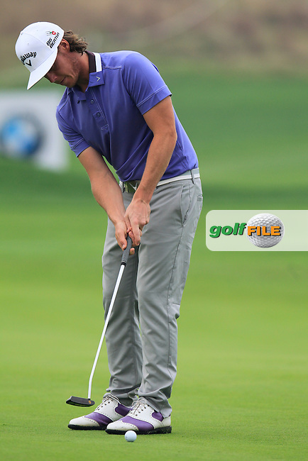 Kristoffer Broberg (SWE) putts on the 5th green during Saturay's Round 3 of the 2014 BMW Masters held at Lake Malaren, Shanghai, China. 1st November 2014.<br /> Picture: Eoin Clarke www.golffile.ie