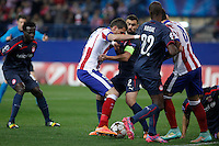 Atletico de Madrid´s Mandzukic (L) and Olympiacos´s Abidal and Maniatis during Champions League soccer match between Atletico de Madrid and Olympiacos at Vicente Calderon stadium in Madrid, Spain. November 26, 2014. (ALTERPHOTOS/Victor Blanco) /NortePhoto
