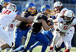 BROOKINGS, SD - NOVEMBER 11: Brady Mengarelli #44 from South Dakota State University tries to slip past Adam Conley #91 and Brandon Barry #5 from Illinois State during their game Saturday afternoon at Dana J. Dykhouse Stadium in Brookings. (Photo by Dave Eggen/Inertia)