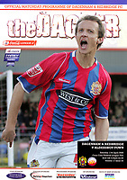 Dagenham & Redbridge Programme Cover - Photo of Paul Benson of Dagenham & Redbridge celebrating a goal - Photo by Rob Newell
