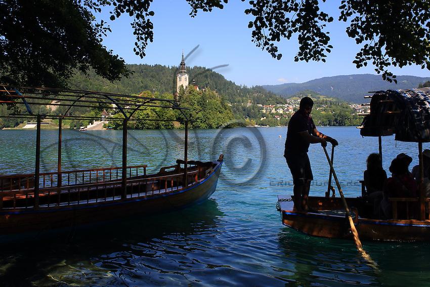 Coming back from a boat ride after visiting the 17th century church on the island in the middle of Lake Bled.///Retour de promenade en bateau après la visite de l'église situé sur l'ile au centre du lac de Bled.