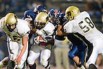 Lawndale, CA 10/21/11 - Dylan Cosgrove (Peninsula #56), Okuoma Idah (Peninsula #24) and Joey Augello (Peninsula #58) in action during the Peninsula - Leuzinger varsity football game.