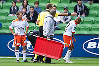 MELBOURNE, AUSTRALIA - SEPTEMBER 12, 2010: Henrique from the Roar leaves the ground after injuing his elbow in Round 6 of the 2010 A-League between the Melbourne Victory and Brisbane Roar at AAMI Park on September 12, 2010 in Melbourne, Australia. (Photo by Sydney Low / Asterisk Images)