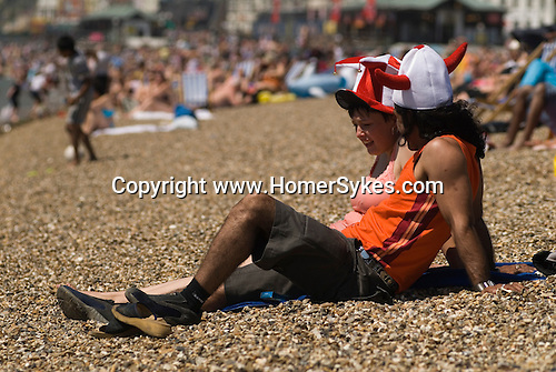 English football fans on the beach, Southend on Sea, Essex. England. 2006