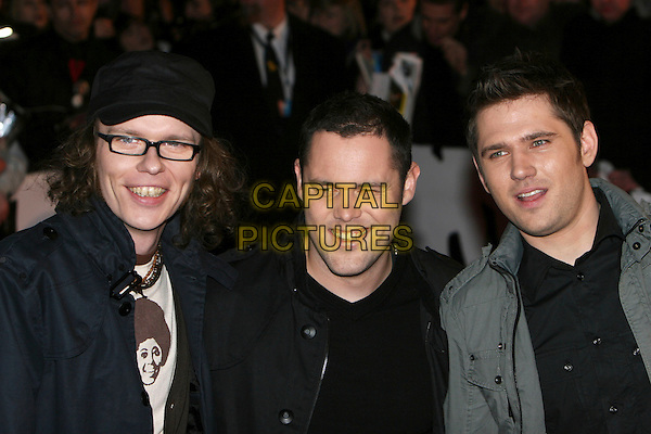 SCOUTING FOR GIRLS.Arrivals - 2009 Brit Awards, Earls Court, London, England, .February 18th 2009.brits headshot portrait black jacket glasses hat grey gray Roy Stride Greg Churchouse Peter Ellard.CAP/MAR.© Martin Harris/Capital Pictures.