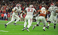 NWA Media/Michael Woods --12/29/2014-- w @NWAMICHAELW...University of Arkansas quarterback Brandon Allen runs the ball during the 4th quarter of the Razorbacks 31-7 win over the University of Texas during the Texas Bowl Monday night at  NRG Stadium in Houston.