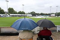 Spectators shelter under umbrellas as rain delays play during Essex CCC vs West Indies, Tourist Match Cricket at The Cloudfm County Ground on 2nd August 2017