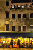 ITALY, Venice. View of diners at Ristorante Antico Martini at night.