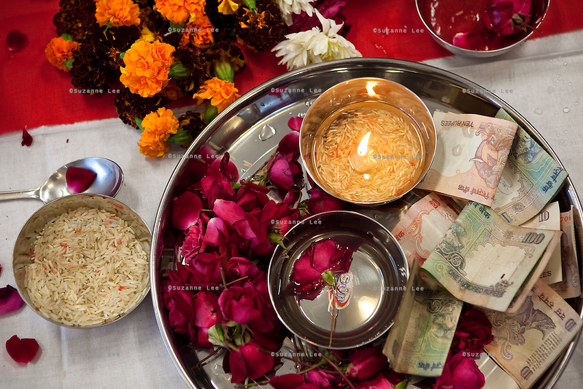 A detail of the altar after the puja (prayer and blessing) ceremony at the opening of the new Bill & Melinda Gates Foundation office in New Delhi, India on 17th December 2010. Photo by Suzanne Lee for Gates Foundation