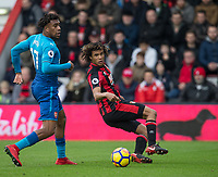 Nathan Ake of AFC Bournemouth & Alex Iwobi of Arsenal during the Premier League match between Bournemouth and Arsenal at the Goldsands Stadium, Bournemouth, England on 14 January 2018. Photo by Andy Rowland.
