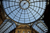 Vaulted glass ceiling of the shopping arcade Galleria Vittorio Emanuele II, Milan, Italy.