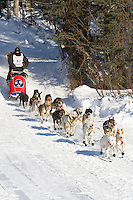 Musher James Bardoner on Long Lake at the Re-Start of the 2011 Iditarod Sled Dog Race in Willow, Alaska.
