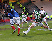 Fiacre Kelleher gets a last ditch tackle on Junior Ogen in the Celtic v Rangers City of Glasgow Cup Final match played at Firhill Stadium, Glasgow on 29.4.13,  organised by the Glasgow Football Association and sponsored by City Refrigeration Holdings Ltd.