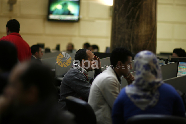 Egyptians work at trading room of the Egyptian stock market in Cairo, Egypt, 23 March 2011. Egypt's benchmark EGX 30 index fell by around 8.9 per cent on 23 March 2011, on the bourse's first day of trading since January 27, despite an upwards rally by local investors in the latter half of the session. A 30 minutes suspension on all trading was enforced after the EGX 30 tumbled by almost 10 per cent minutes after trading began. Photo by Wissam Nassar