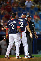 Reading Fightin Phils shortstop J.P. Crawford (2) and manager Dusty Wathan (62) argue a strike three call with umpire Paul Clemons during a game against the New Britain Rock Cats on August 7, 2015 at FirstEnergy Stadium in Reading, Pennsylvania.  Reading defeated New Britain 4-3 in ten innings.  (Mike Janes/Four Seam Images)