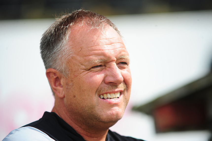 Lincoln City's Manager Gary Simpson <br /> <br /> Photographer Chris Vaughan/CameraSport<br /> <br /> Football - Friendly - Lincoln City v Chesterfield - Saturday 19th July 2014 - Sincil Bank Stadium - Lincoln<br /> <br /> &copy; CameraSport - 43 Linden Ave. Countesthorpe. Leicester. England. LE8 5PG - Tel: +44 (0) 116 277 4147 - admin@camerasport.com - www.camerasport.com