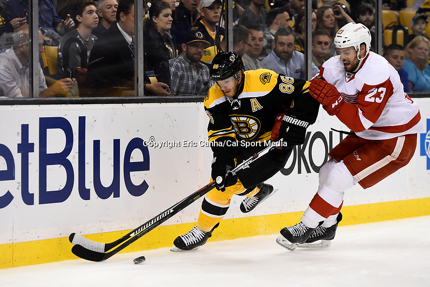 Monday, September 28, 2015, Boston, MA - Detroit Red Wings defenseman Brian Lashoff (23) and Boston Bruins defenseman Kevan Miller (86) battle for the puck during the NHL game between the Detroit Red Wings and the Boston Bruins held at TD Garden, in Boston, Massachusetts. Detroit defeats Boston 3-1 in regulation time. Eric Canha/CSM