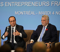 Montreal,  CANADA - November 4 - French President Francois Hollande (L)<br /> Quebec Premier Phillipe Couillard (R)  meet with the business community in Montreal, November4, 2014.<br /> <br /> Hollande did a 3 day visit to Canada.<br /> <br /> Photo :  Agence Quebec Presse - Pierre Roussel
