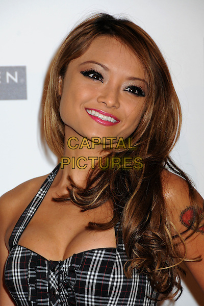 TILA TEQUILA.Apple Lounge Grand Opening Party at Apple Lounge on Robertson, West Hollywood, California, USA..August 14th, 2008.headshot portrait cleavage black plaid tartan halterneck .CAP/ADM/BP.©Byron Purvis/AdMedia/Capital Pictures.