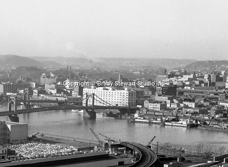 Pittsburgh Pa:  View of the North Side and bridges from the Penn Station roof - 1959.  View includes the 7th and 9th street bridges, B&O Railroad building and Fort Pitt Hotel. View also includes the destruction of the railroad tracks from Penn Station to the Wabash terminal to make way for Fort Duquesne Boulevard.