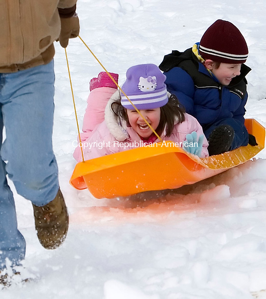 SEYMOUR, CT- 18 MARCH 07- 031807JT04- <br /> Peyton Iott, 5, and her brother Noah, 4, laugh as their father Eric drags them up the hill in the snow in front of Bungay Elementary School in Seymour on Sunday.<br /> Josalee Thrift Republican-American