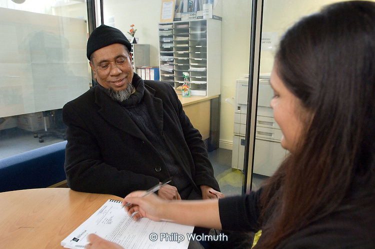 Nasima Roman, coordinator of the Westminster Older Peoples Advisory Project, at an advice session at the Marylebone Bangladeshi Society, Church Street
