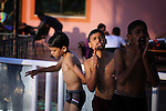 A picture taken on August 10, 2013 shows Palestinian boys swimming at a pool in Gaza City. Photo by Mahmoud Hamda