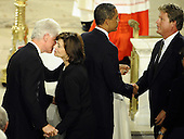 Boston, MA - August 29, 2009 -- Former President Bill Clinton (L) embraces widow Vicki Reggie Kennedy (2-L) and  President Barack Obama (2-R) shakes hands with Edward Kennedy Jr. (R) in front of the casket (C) of US Senator Edward Kennedy is seen inside the Basilica of Our Lady of Perpetual Help Catholic Church in Boston, Massachusetts, USA for the funeral Mass for Kennedy 29 August 2009. Senator Edward Kennedy, 77, died 25 August 2009 after a battle with brain cancer. .Credit: CJ  Gunther - Pool via CNP