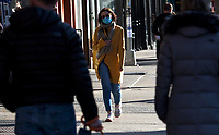 NEW YORK, NY - MARCH 21: A woman walks wearing a face mask on March 21, 2020 in New York City. New York Governor Cuomo orders non-essential workers to stay home as the COVID-19 pandemic reaches nearly 11,000 and 56 deaths in New York (Photo by Pablo Monsalve / VIEWpress via Getty Images)