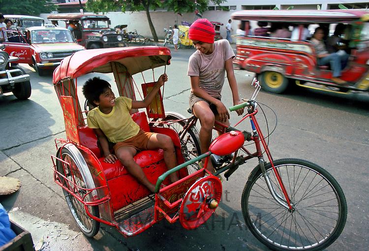 Children on rickshaw, Manila, Philippines