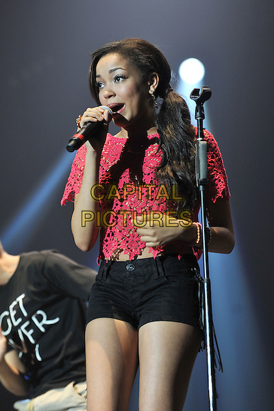 Dionne Bromfield .Performing live at the 'Girlguiding UK  Big Gig' at Wembley Arena, London, UK, 1st October 2011..music concert  live on stage half  length red lace crop top black hotpants shorts microphone singing .CAP/MAR.© Martin Harris/Capital Pictures.