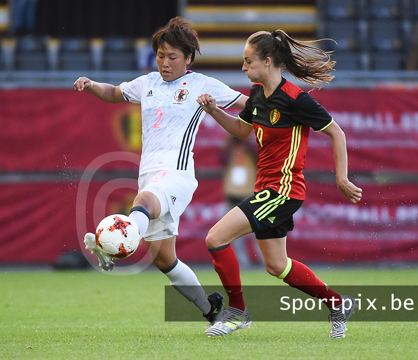 20170613 - LEUVEN ,  BELGIUM : Belgian Tessa Wullaert (R) and Japanese Hikari Takagi (L) pictured during the female soccer game between the Belgian Red Flames and Japan , a friendly game before the European Championship in The Netherlands 2017  , Tuesday 13 th Juin 2017 at Stadion Den Dreef  in Leuven , Belgium. PHOTO SPORTPIX.BE | DIRK VUYLSTEKE