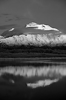 Mount McKinley, the tallest mountain in the United States at 20,320' reflects at midnight in Reflection Pond.  Denali National Park, Alaska.