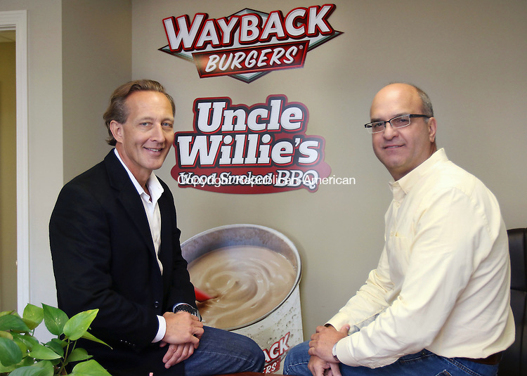 CHESHIRE CT. 16 October 2015-101615SV02-From left, John Carter, founder and CEO, and John Eucalitto, president, of Wayback Burgers work in their headquarters in Cheshire Friday. <br /> Steven Valenti Republican-American