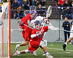 Connor Fields (#5) and Richmond goalkeeper Blake Goodman (#30) watch as Fields' shot hits the net.  UAlbany Men's Lacrosse defeats Richmond 18-9 on May 12 at Casey Stadium in the NCAA tournament first round.
