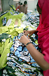A Bangladeshi woman producing the H&M bath shirts in Banga Garment Ltd, Dhaka