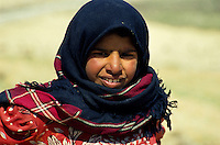 Portrait of a Bedouin girl wearing a veil, Jordan.