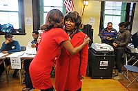 Candidate Carol Moseley Braun, a former U.S. Senator and Ambassador to New Zealand, receives a hug from a supporter at Ray School in Hyde Park after voting in the Chicago mayoral elections in Chicago, Illinois on February 22, 2011.